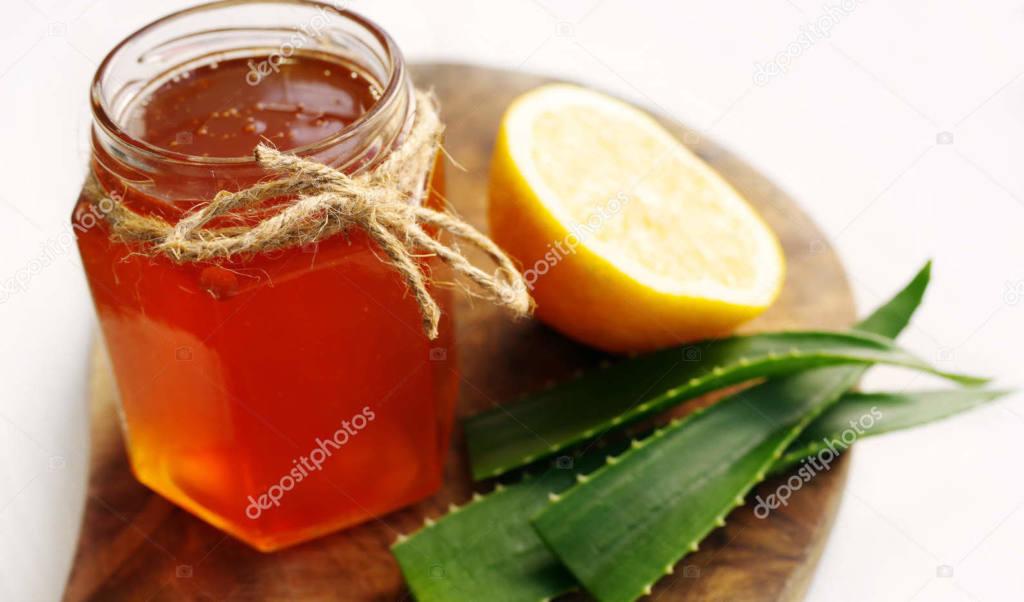 depositphotos_146278857-stock-photo-honey-in-a-glass-jar